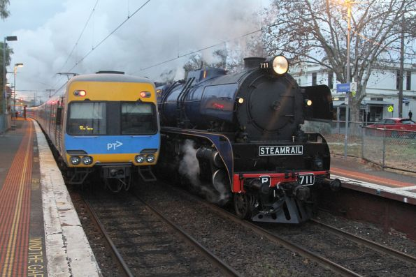R711 leads the down train through Kensington