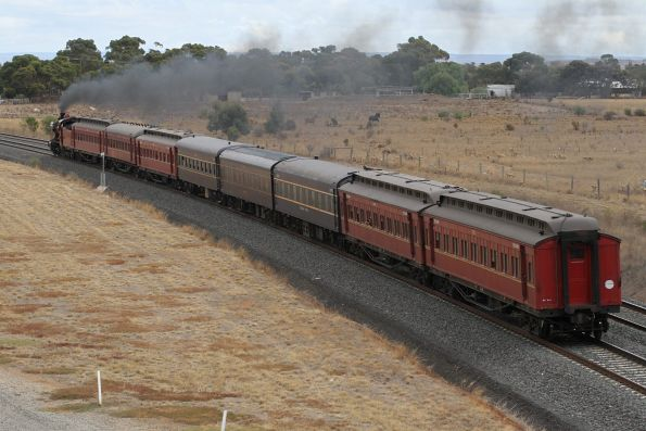 K190 leads the train  towards Geelong in the nothingness west of Tarneit