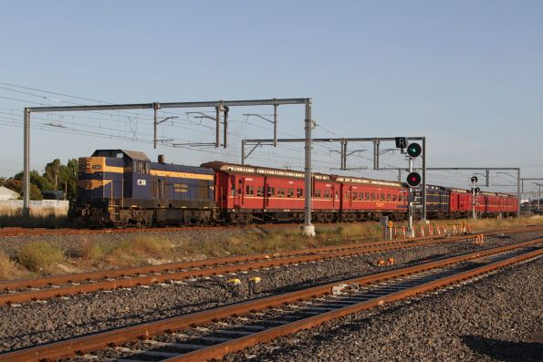 T356 leads a 6 carriage long train through Sunshine on the down