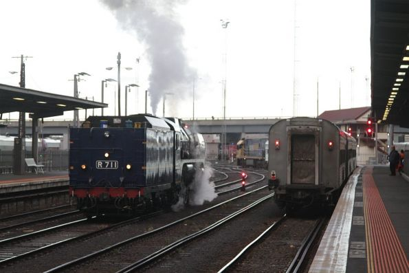 R711 runs around the train at Southern Cross Station, as the westbound Overland departs