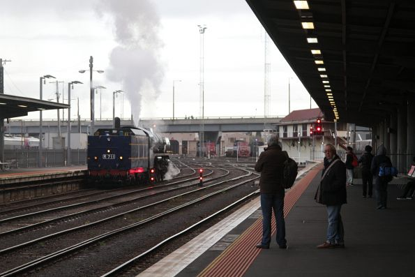 R711 shunts back onto the carriages at Southern Cross Station