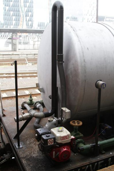 Pipes, petrol powered water pump and control electronics attached to the water gin