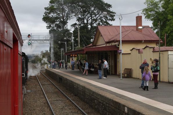 Mixture of V/Line passengers and onlookers on the platform at Gisborne