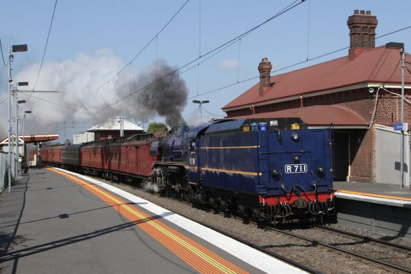R711 leads the train tender first at Yarraville, headed from Newport to Southern Cross