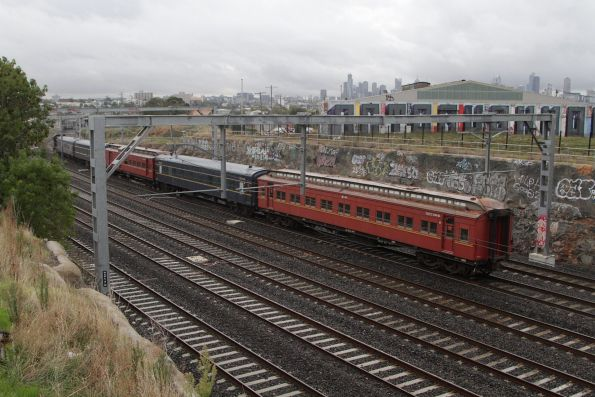 T364 leads the empty cars move out of Footscray