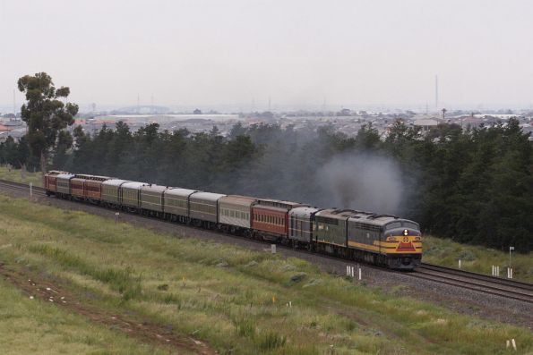 S313 leads the train out of Melbourne at Deer Park West