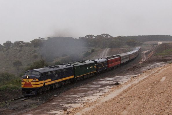 The rain has come in as the train climbs up towards Bank Box Loop