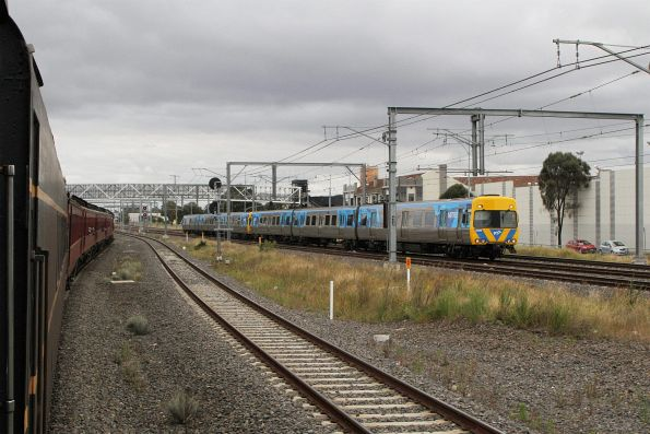 T356 leads the train over to the suburban tracks, with life extension Alstom Comeng 350M headed the other way