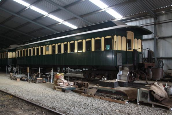 Wooden bodied end platform carriages in the shed