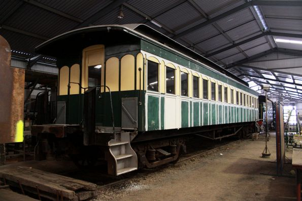 Wooden carriage getting touched up before a repaint