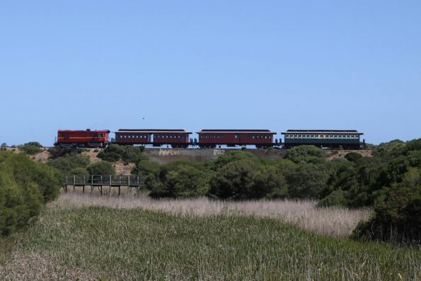 Train crossing the concrete arch bridge at Watsons Gap