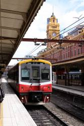 Solo Sprinter 7001 heads through Flinders Street empty cars bound for Frankston