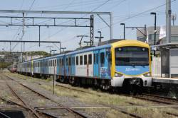 Siemens at Frankston platform 2, as the Sprinters on the Stony Point service creep in behind