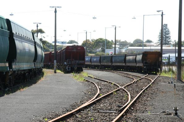 Stored wagons at Portland: VHNY to the left, then VHCF weighbridge test wagons (ex-VHCA cement hoppers) then a rake of VHGYs