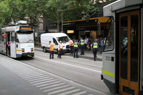 Southbound trams still running past the stuck van