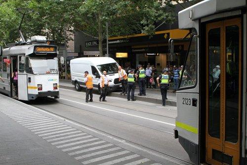 Southbound trams still running past the stuck van