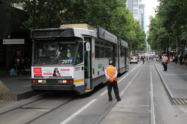 Driver of B2.2077 waits at Bourke Street to head 'bang road' down Swanston Street