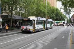 Having run 'bang road' down Swanston Street from Bourke Street, B2.2077 waits to shunt through the Flinders Lane crossover