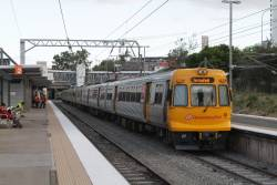 EMU48 trails a Springfield bound service at Bowen Hills