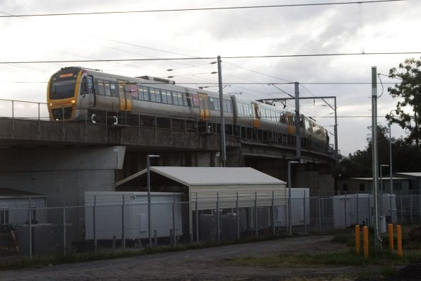IMU165 crosses the Ferny Grove flyover with a Gold Coast bound service ex-Mayne Yard
