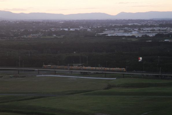 Train crosses the Airtrain viaduct bound for Brisbane Airport