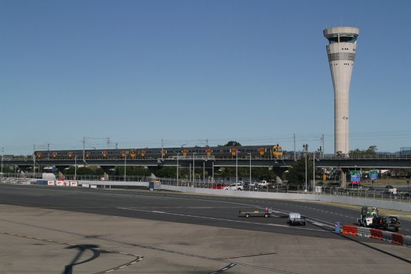 Suburban train passes the control tower at Brisbane Airport