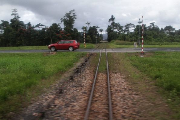 Tramway crosses both road and the QR tracks, north of Tully