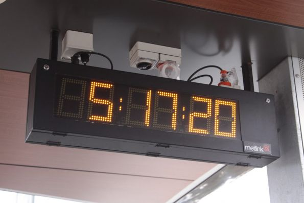 LED clock at Diggers Rest, with a dodgy 'Metlink' sticker affixed