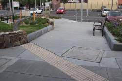 Tactile paving leading into a garden bed at Sunbury station