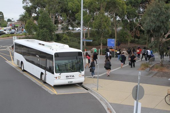 Sita bus #220 BS00RK arrives at Sunshine station with a packed train replacement service