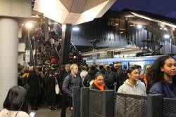 Overcrowded platform at Sunshine following a fatality at Ginifer