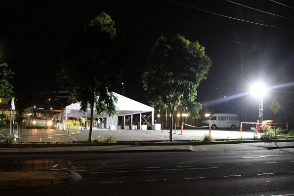 Night time at the temporary rail replacement bus interchange at Sunshine station