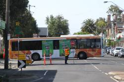 Transdev bus #377 4081AO departs Sunshine station on a Sunbury line rail replacement service