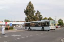 Dysons bus #1100 BS04NG departs Sunshine station on a Sunbury line rail replacement service