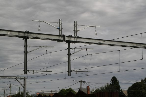 Brackets to hold additional traction feeder cables installed at Middle Footscray