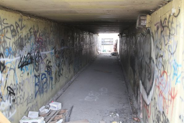 Abandoned underpass filled with rubbish and debris