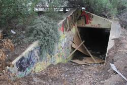 Mound of dirt and a broken timber wall blocks the railway end of the abandoned underpass