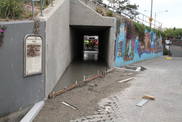 Concreting the reopened pedestrian underpass at Sunshine station, to form part of the new Sunshine-Albion bike path