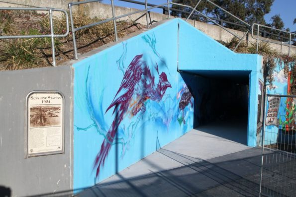 Painting a mural in the reopened pedestrian underpass at Sunshine station, to form part of the new Sunshine-Albion bike path