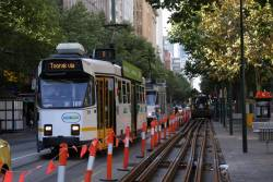 Z3.189 passes new rail laid out on Swanston Street at Flinders Street