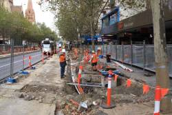 They're still stuffing around with building the Swanston Street tram stops?