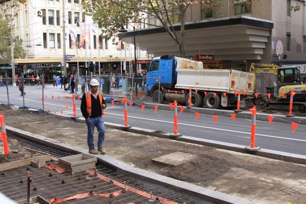 Tram stop work continues slowly at Swanston and Bourke Streets