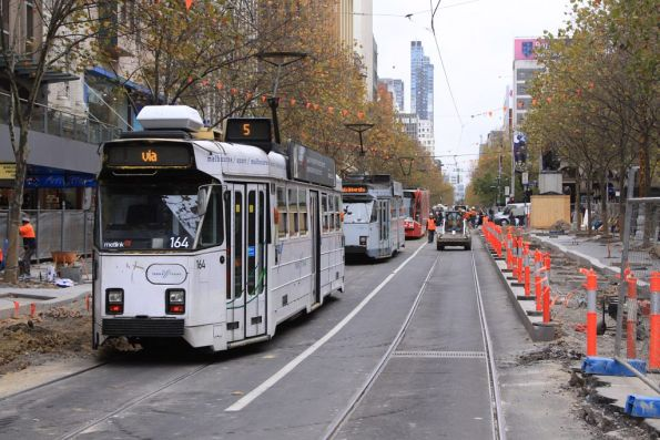 Z3.164 trails a line of trams in the middle of the platform stop works at Swanston Street and Flinders Lane