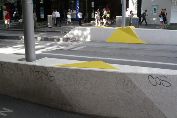 Random yellow bits added to the Bourke Street tram stop on Swanston Street