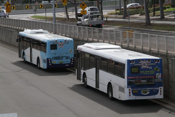 Busabout buses parked between ruins at Campbelltown station