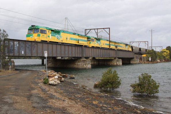 Centennial Coal's CEY004, CEY007 and CEY005 lead a down coal train over Brisbane Water at Woy Woy
