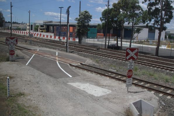Level crossing on the Southern Sydney Freight Line at Leightonfield