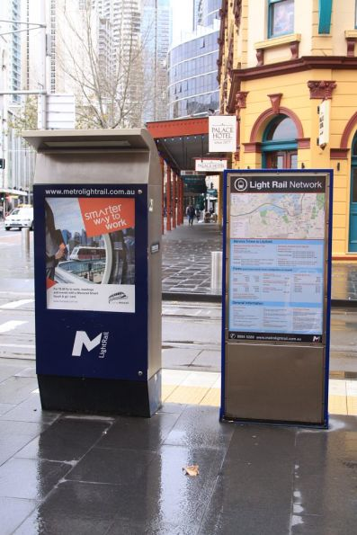 Former ticket machine beside a network map at the Capitol Square stop