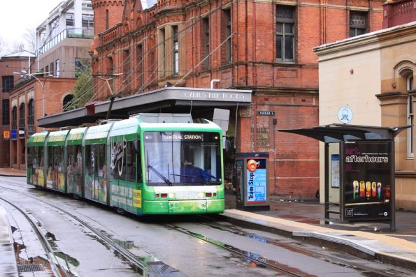 Variotram 2107 in Paddy's Market livery heads west along Hay Street at George Street