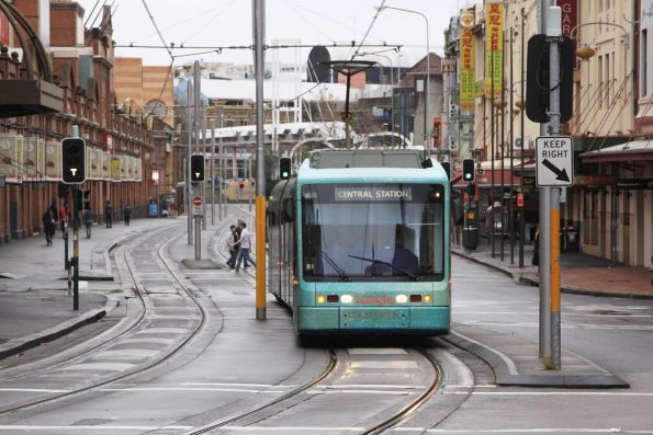 Narnia liveried tram heads towards Central Station at George Street